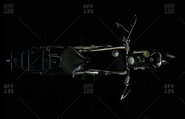 Top view of vintage motorcycle with black background (NSU OSL 351)
