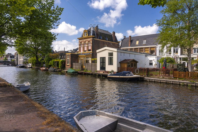 Netherlands- South Holland- Leiden- Boats and houses along city canal