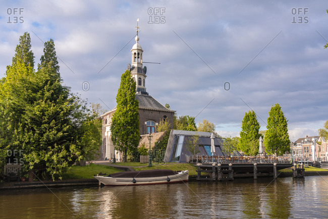 Netherlands- South Holland- Leiden- City canal with Zijlpoort gate in background