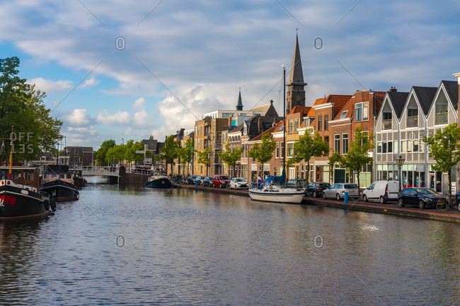 Netherlands- South Holland- Leiden- Townhouses and canal by Herengracht street