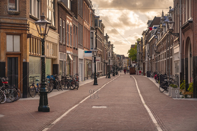 Netherlands- South Holland- Leiden- Haarlemmerstraat street at dusk