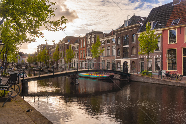 Netherlands- South Holland- Leiden- Bridge and historical houses on Oude Rijn canal