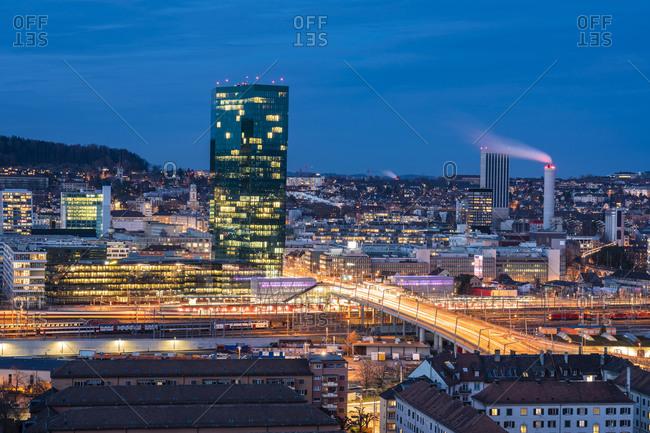Switzerland- Zurich- Cityscape with Prime Tower and Hard Bridge illuminated at night