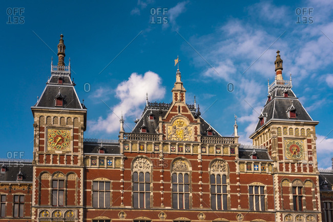 Netherlands- North Holland- Amsterdam- Ornate exterior of Amsterdam Central Railroad Station