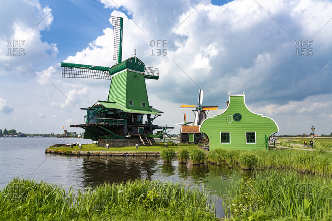 Netherlands- North Holland- Amsterdam- Historic windmill on bank of Zaan river