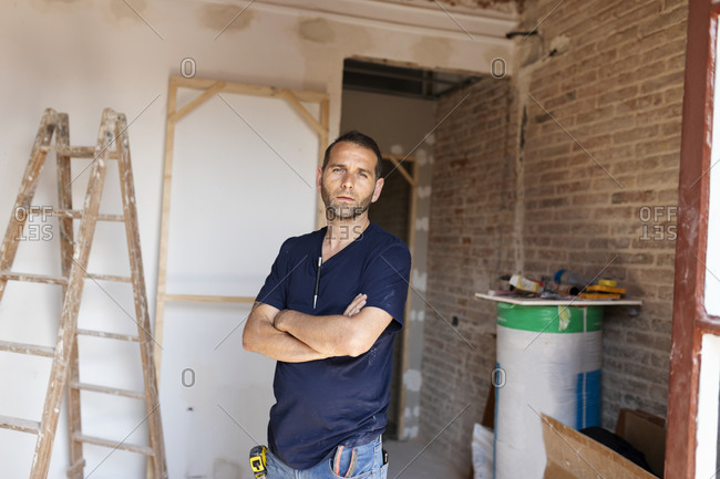 Portrait of a confident man in a house under construction