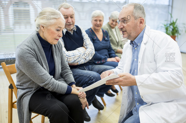 Group of seniors attending health counselling in retirement home