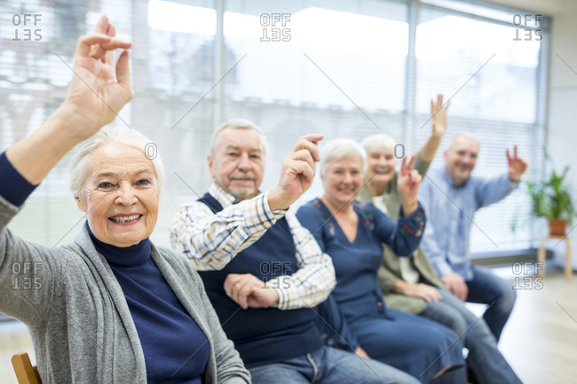 Senior citizens participating in group event in retirement home