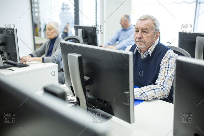 Active seniors attending computer course- working on PC