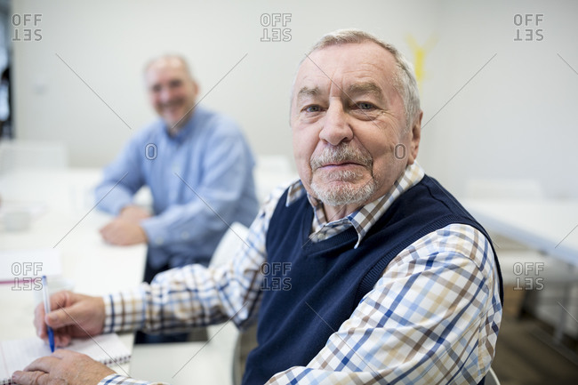 Senior man attending seniors education course