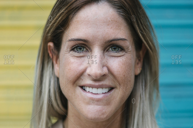 Close-up of happy mid adult woman with hazel eyes