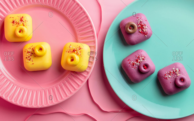 Raw desserts without gluten, sugar and flour on color plates