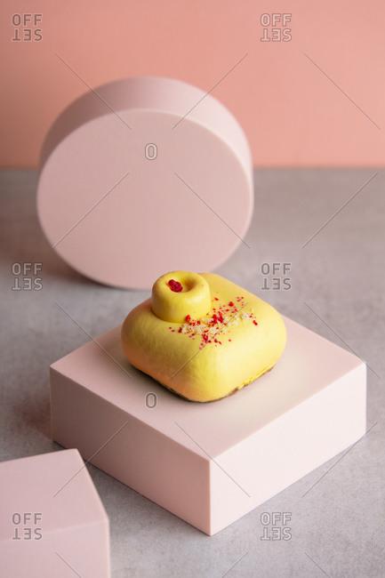 Raw dessert without gluten, sugar and flour on pink block