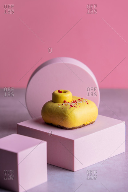 Raw dessert without gluten, sugar and flour on blocks in front of pink background