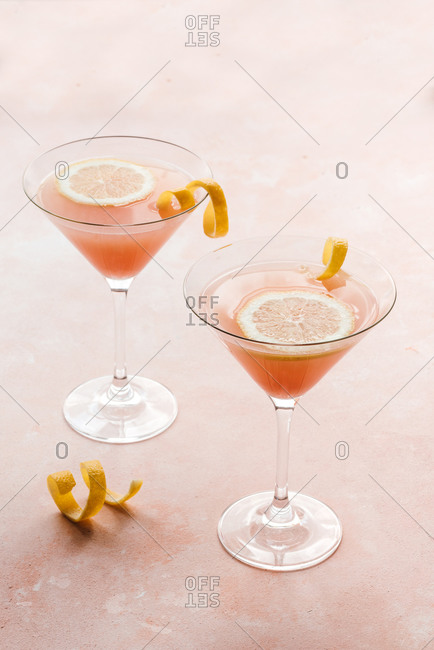 Two pink cocktails on pink background