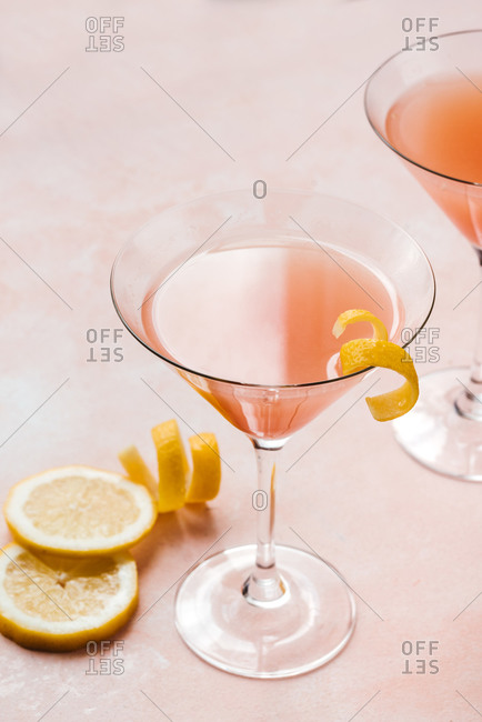 Pink cocktail glasses with some lemon