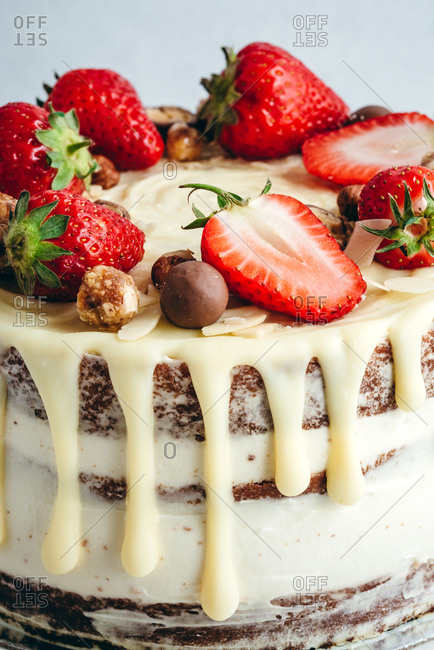 Creamy naked cake with white chocolate and strawberries