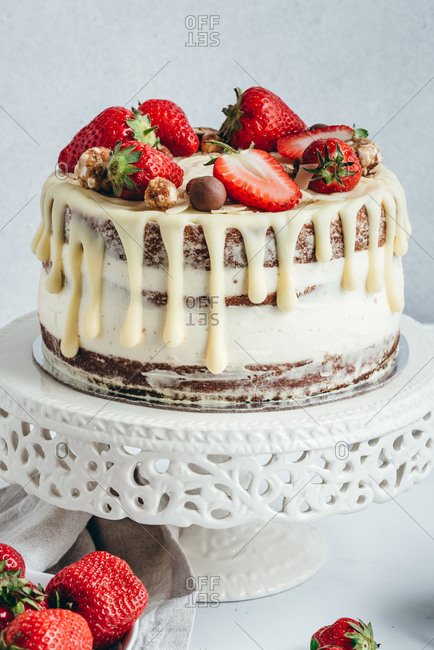 Creamy cake with white chocolate and strawberries on top