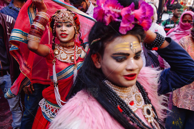 India - March 9, 2020: Group of ethnic women in colorful clothes dancing in street during festival