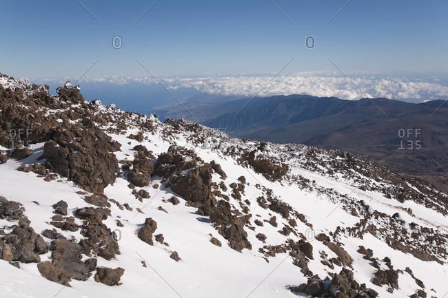 Snow on rocky mountainside