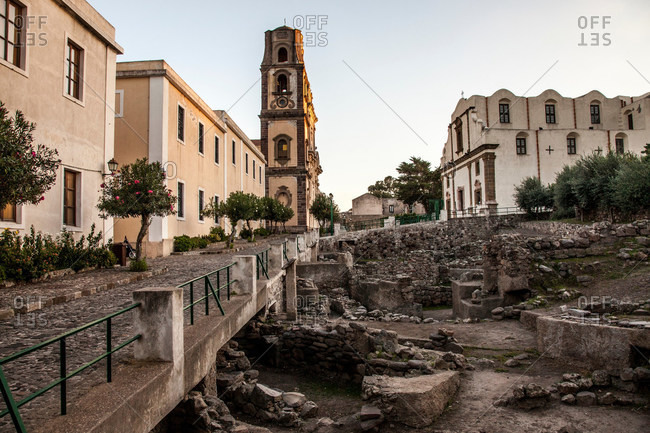 Bell tower overlooking village and ruins