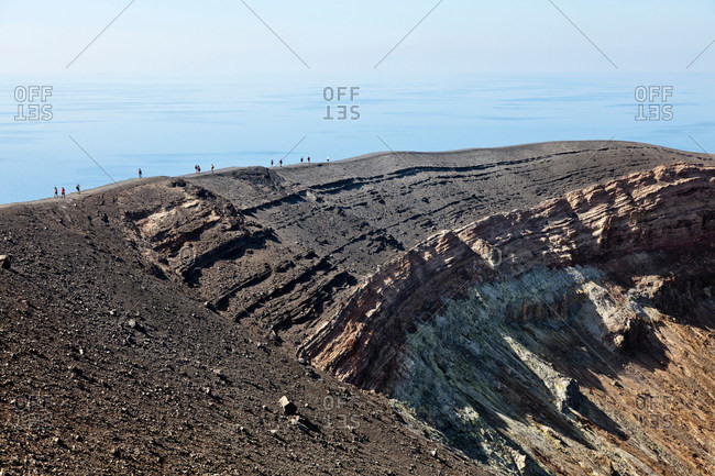 Hikers walking on rocky slope