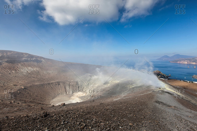 Hot spring in dusty crater