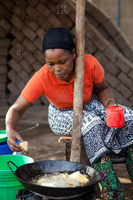 Woman cooking food outdoors - Offset