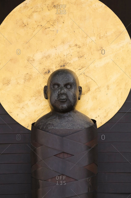 Religious statue on wall - Offset