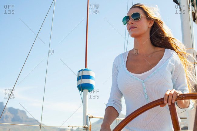 Woman steering a big yacht