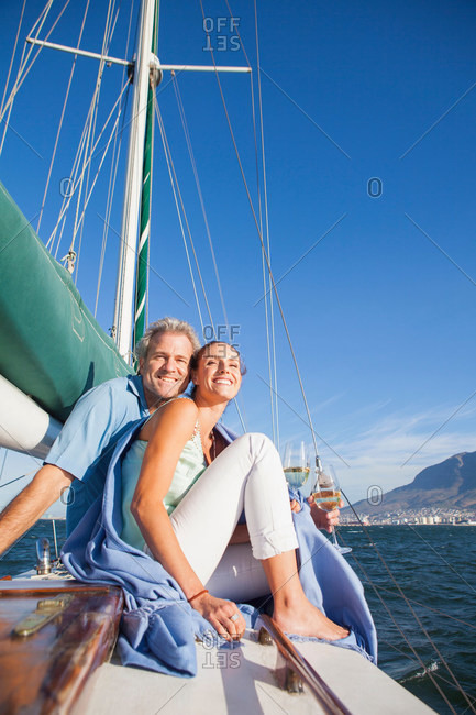 Couple on yacht with wine