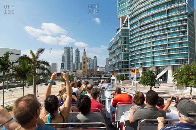 Tourists on a bus in downtown Miami, Florida, USA