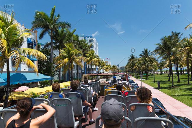 Tourists on a bus in Miami Beach, Florida, USA