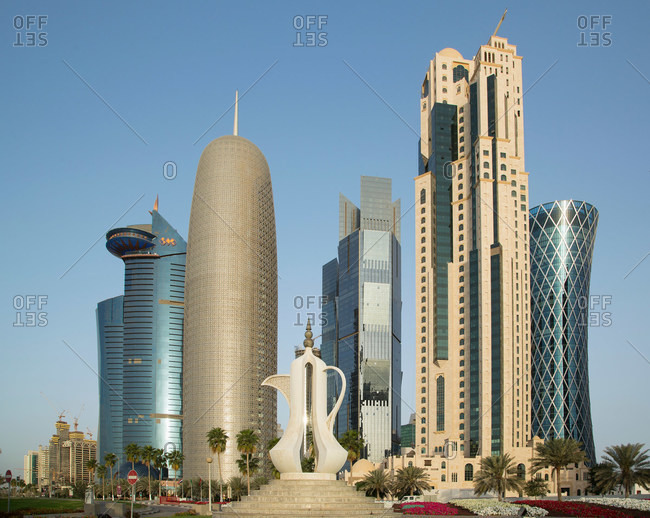 Futuristic skyscrapers and giant coffee pot (dallah) sculpture in downtown Doha, Qatar