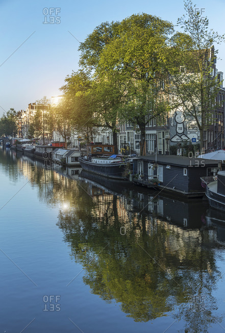 Stationary barges on canal, Amsterdam, Netherlands