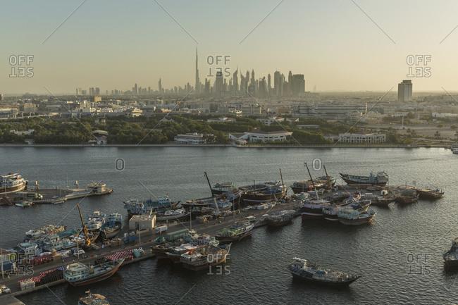Dubai skyline and traditional boats on Dubai Creek