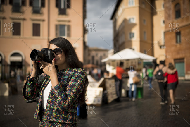 Woman taking pictures with DSLR Camera, Piazza Navona, Rome, Italy