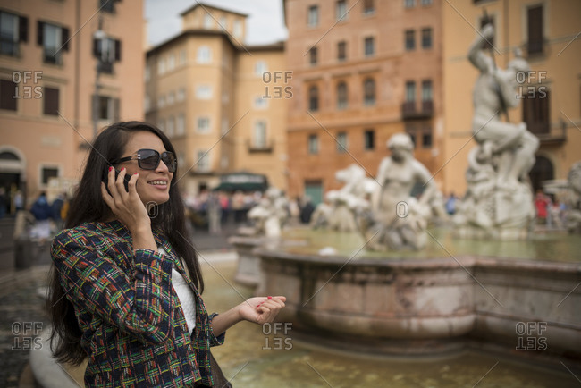 Woman using mobile phone, Piazza Navona, Rome, Italy
