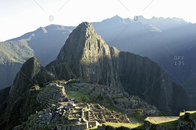 View of sunbeam over Huayna Picchu at dawn Machu Picchu, Sacred Valley, Peru, South America