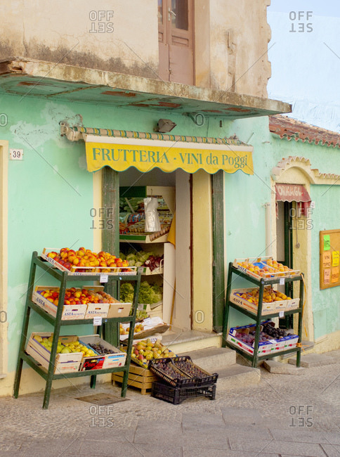 Fruit shop with shelves of fruit on display, Sardinia, Italy
