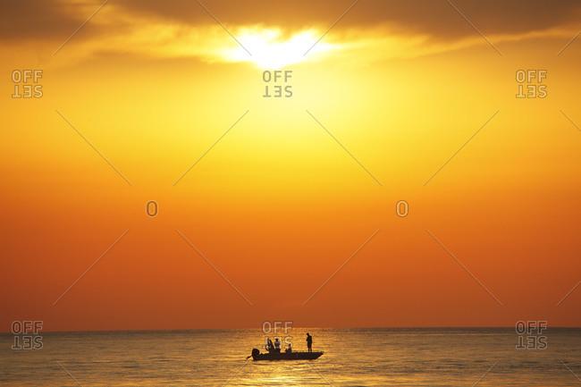 Fisherman's boat in Tirreno sea at sunset, Marina Pisa, Tuscany, Italy