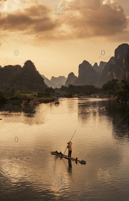 Fisherman on river in Yangshuo, Guangxi Province, China