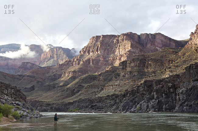 Person wading in Colorado River, Grand Canyon, Arizona, USA