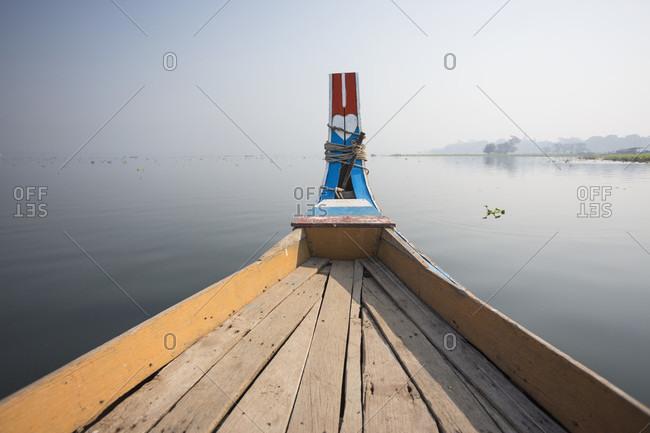 Traditional boat on Taungthaman Lake, Amarapura, Mandalay, Myanmar