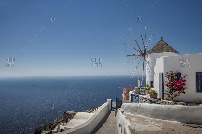 White washed windmill and mediterranean, Santorini, Greece