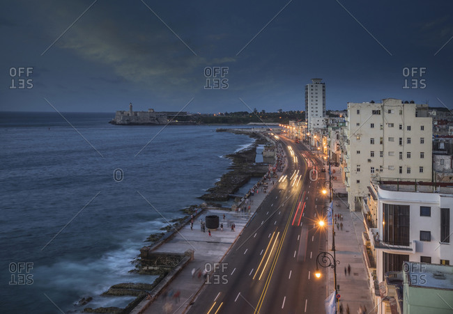 High angle view of traffic on El Malecon at dusk, Havana, Cuba