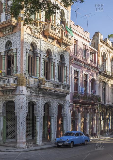 Blue vintage car and colonial architecture at Paseo del Prado, Havana, Cuba