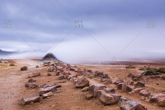 Rocky landscape and steam from geothermal spring, Namaskard, Sudur Thingeyjarsysla, Iceland