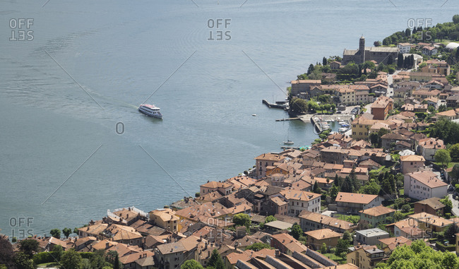 High angle view of ferry approaching waterfront village,  Lake Como, Italy