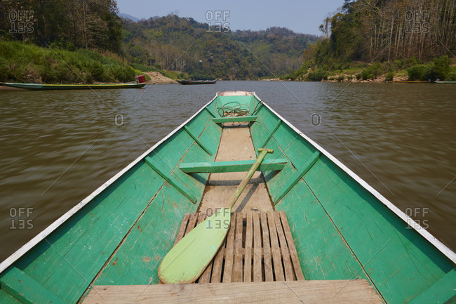 Green rowing boat on river, Luang Prabang, Las